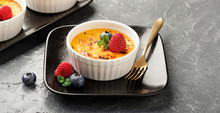 Creme Brulee. Traditional French Vanilla Cream Dessert With Caramelised Sugar On Top And Fresh Berry. - Image