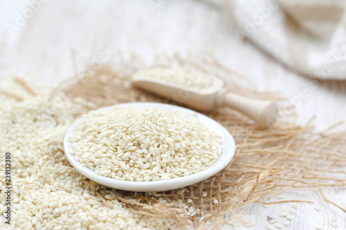 Sesame seeds in a bowl on a wooden table