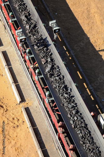 Close up of Manganese rock on a conveyor belt - Buy this stock photo