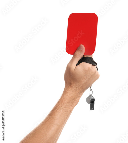 Man holding red card and whistle on white background, closeup of hand