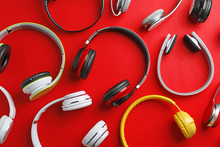 Many Different Headphones On Color Background, Top View