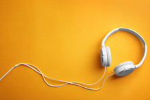 Stylish Headphones On Color Background, Top View. Space For Text