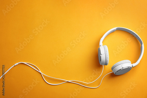 Fotografie, Obraz  Stylish headphones on color background, top view. Space for text