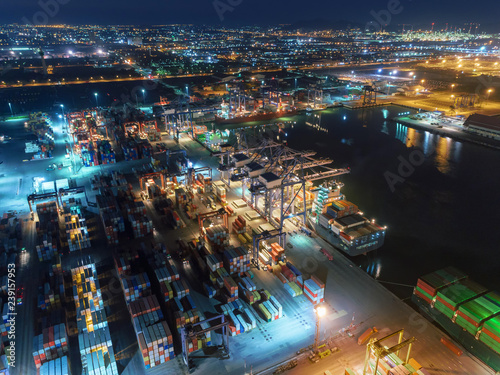 Aerial view container ship at container warehouse at sea