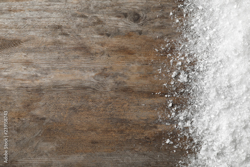 Obraz White snow and space for text on wooden background, top view - fototapety do salonu