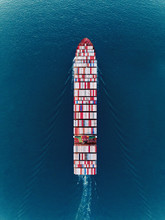 Aerial Top View Container Ship On The Sea Full Load Container For Import Export, Shipping Or Transportation.