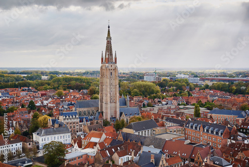 Wall Murals Bridges Aerial view of medieval houses and tower of Church of Our Lady in belgian town Bruges
