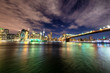 Manhattan skyline and Brooklyn Bridge by night