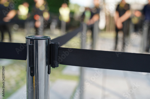 Fotografie, Obraz  Focus barricade, stainless pole and black tape.