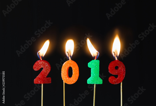 Happy New Year 2019 With Sparkler Colorful Glitter Candles Number Burning Shine In Black Background Countdown