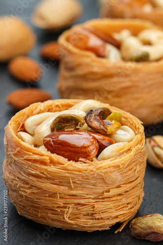 Traditional middle Eastern sweets bird's nest in honey syrup with nut filling - almonds, cashews, pistachios Canvas Print