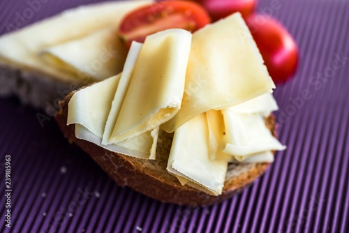 Sliced cheese on bread.