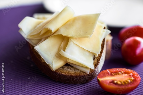 Bread with emmental, cherry tomato.