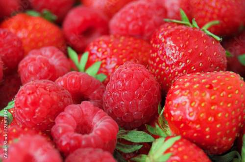 tasty strawberries and raspberries background