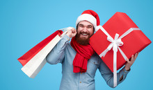 Cheerful Man In Stylish Winter Clothes Doing Christmas Shopping