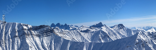 Foto auf Leinwand Gebirge Large panorama of snowy mountains and blue sky