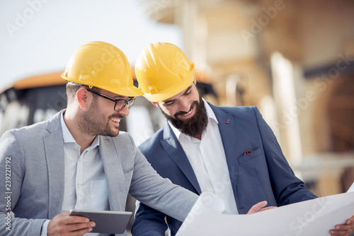 Canvas Prints Textures Two engineers in hardhat using a tablet