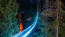 Capilano Bridge At Night Around Christmas Time. Lights And Glitters In The Background.