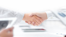 Close Up. Handshake Of Financial Partners After Signing The Cont