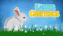 Easter Greetings Bunny Twitch Loop Features A Cartoon Bunny Blinking And Twitching Its Ears In A Field Of Grass And Flowers With An Animated Easter Greetings Message