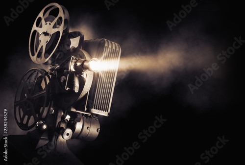 Photo film projector on a dark background