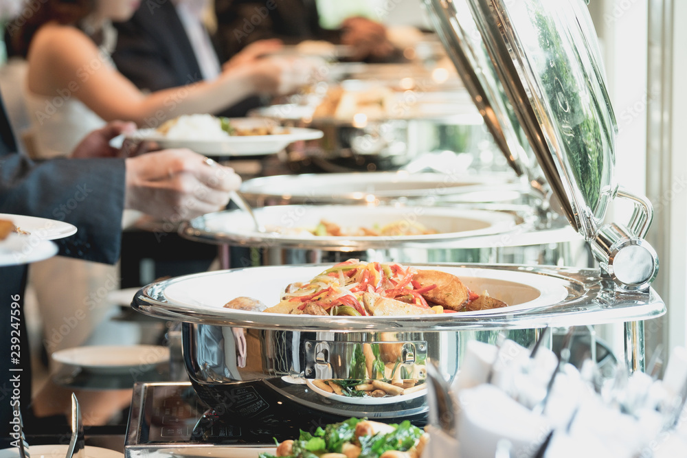 Fototapeta people group catering buffet food indoor in luxury restaurant with meat colorful fruits and vegetables