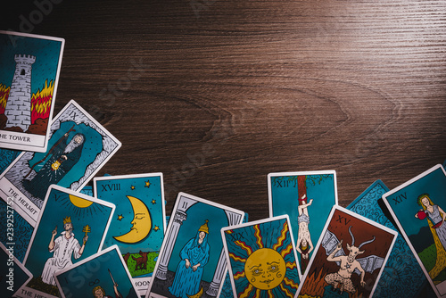 Tarot cards on a wooden background Fotobehang