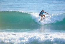 Man In The Ocean On A Surfboar...