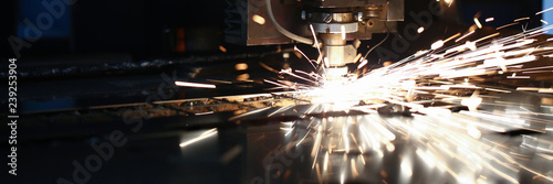 Keuken foto achterwand Metal Sparks fly out machine head for metal processing