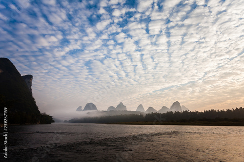 Early morning altocumulus clouds and river scene Wallpaper Mural