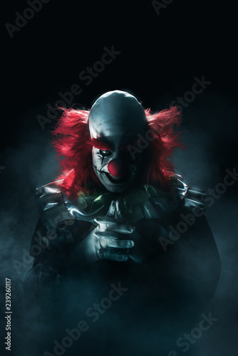 Scary clown on a dark background Fototapete