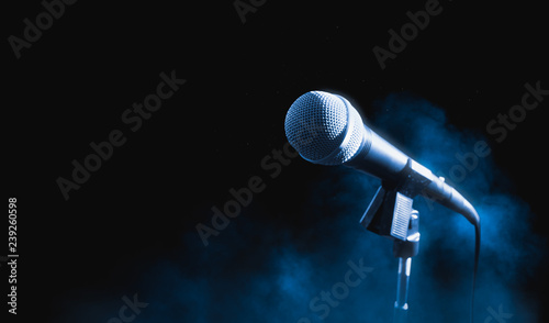 Fotografie, Obraz  microphone on a stand on a dark background with smoke