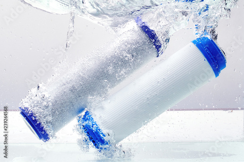 Fotografia, Obraz  New carbon filter cartridge for house water filtration system isolated on white background