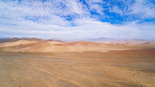 Aerial View Of Desert Landscape Of The Atacama Region, Chile. You Can See The Great Extent Of The Desert