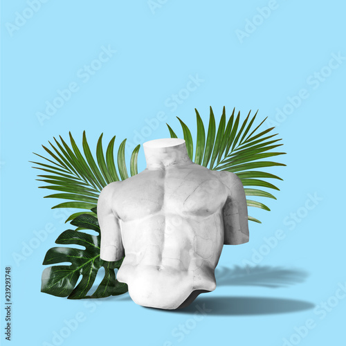 Body of statue with palm leaves on blue background. Minimal art fantasy concept. Wall mural