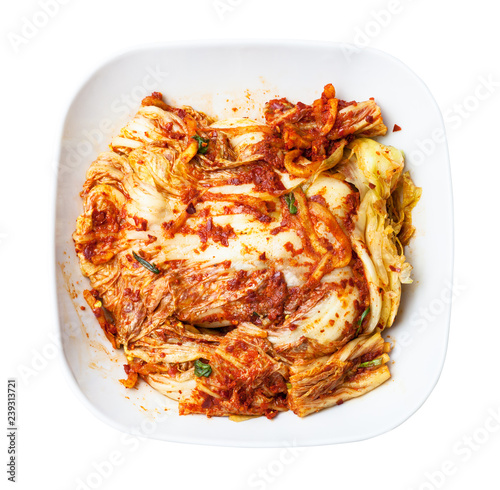 top view of kimchi in white bowl isolated