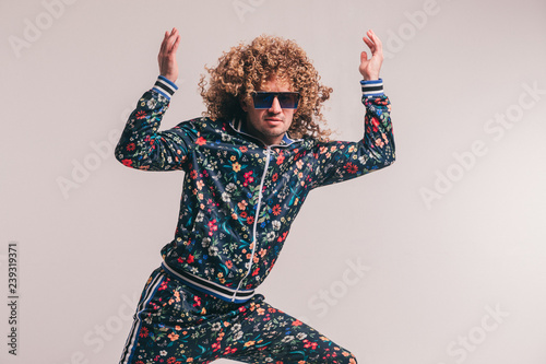 f110f61a197d Excited adult funny man in stylish vintage clothes posing on white studio  background. 80s fashion