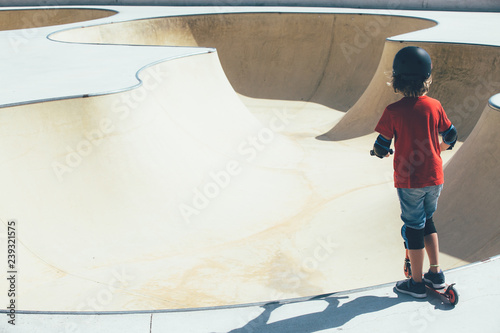 Child in the urban skate park