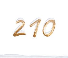 Gold Number 210 With Snow On White Background