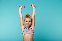Smiling Little Sports Girl Doing Exercises With Dumbbells