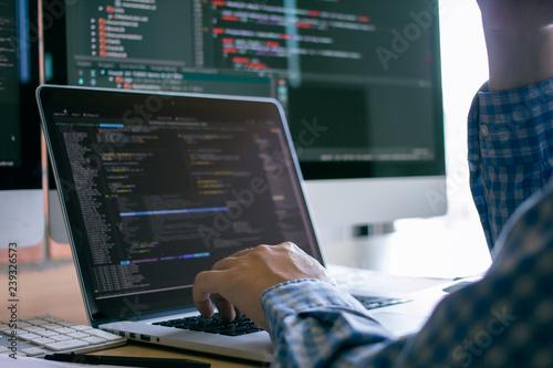 Fotografía  Developer programming and coding technology