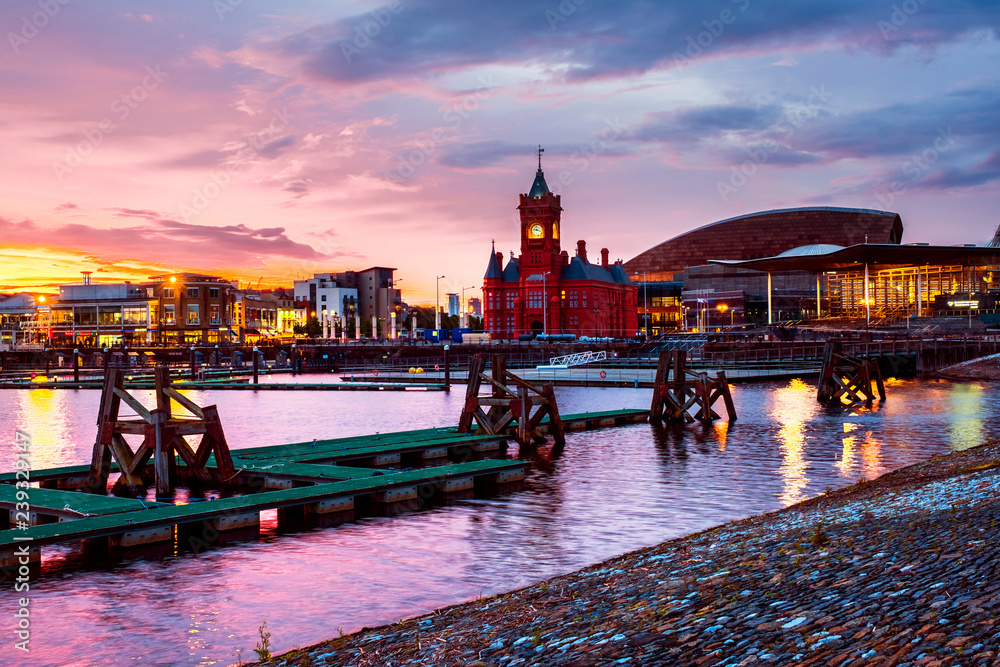 Fototapety, obrazy: Waterfront at night in Cardiff, UK. Sunset colorful sky with Wales Millennium Center