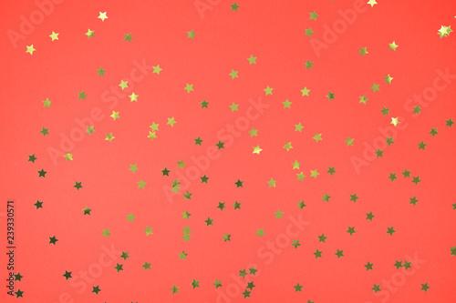 Fotografia, Obraz  Coral multipurpose background with golden star shaped confetti accents