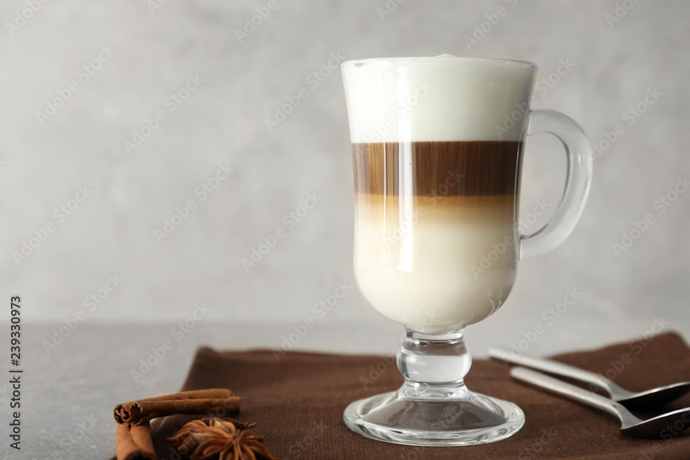 Fototapety, obrazy: Glass cup of tasty aromatic latte on table