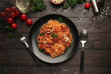 Plate With Delicious Pasta Bolognese On Dark Wooden Table