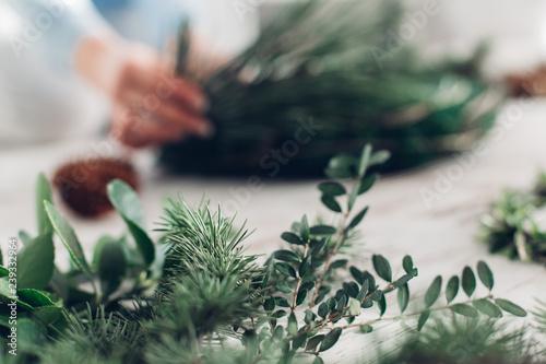 Woman Making A Christmas Wreath Canvas Print