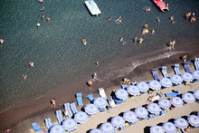 View Directly Above Rows Of Umbrellas On Beach