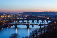 Dusk Lights Up The Historical Bridges And Buildings Reflected On Vltava (Moldava) River Prague Czech Republic Europe