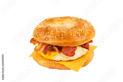Close up on a sandwich breakfast isolated on white background. Bagel, egg, cheese and bacon.