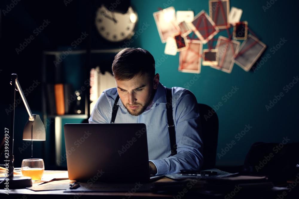 Fototapeta Detective processing evidence in office